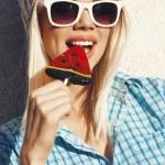 Sweet girl sucking lollipop — Stock Photo #35972901