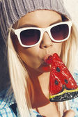 Sweet girl sucking lollipop — Stock Photo