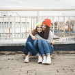 Two young longboarding girl friends — Stock Photo #38250535