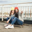 Two young longboarding girl friends — Stock Photo