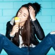 Naughty girl eating ice cream — Stock Photo #38263379