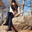 Стоковое фото: Beautiful elegant woman standing in a park in autumn