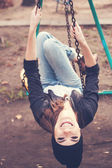 Gentle portrait of a beautiful girl on a swing — Stock Photo