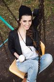 Gentle portrait of a beautiful girl on a swing — Stock Photo