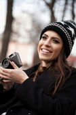 Beautiful girl and old camera — Stock Photo