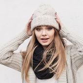 Fashionable stylish girl in white knit jacket — Stock Photo