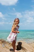 Young beautiful girl standing on beach — Stok fotoğraf