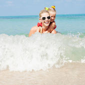 Happy family resting at beach in summer — Stock Photo