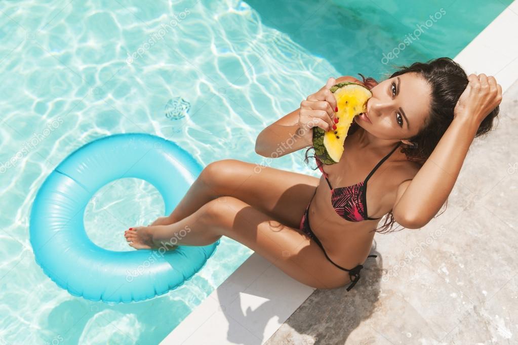 Girl Eating Watermelon Against Swimming Pool Stock Photo Johan Jk 46749141