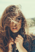 Hipster girl with windy hair — Stock Photo