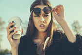 Hipster woman with cup of coffee — Stock Photo
