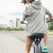 Young hipster girl with black bike — Stock Photo #48720739