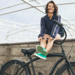Young hipster girl with black bike — Stock Photo #48720973