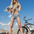 Young sexy woman with bike outdoors — Stock Photo #49267787