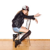 Woman in bicycle helmet showing biker — ストック写真