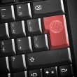 E-commerce concept image. Highlighted keys with sign on a black keyboard closeup. — Stockfoto