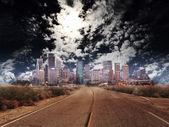 Stadens silhuett genom natten — Stockfoto