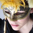 Elegant girl with a wonderful mask — Stock Photo