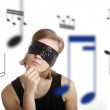Blind young woman listening music — Stock Photo #18479055