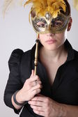 Elegante mädchen mit einer wunderbaren maske — Stockfoto
