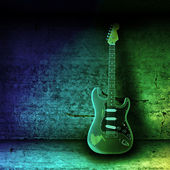 Electric guitar and the wall — Stockfoto