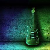 Elektrische gitaar en de muur — Stockfoto