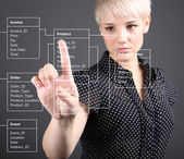Database Table - technical concept, girl pointing screen — Stok fotoğraf