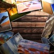Photos on the wood desk - Stock Photo