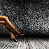Woman's Legs Wearing Pantyhose and High Heels — Stock Photo