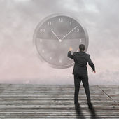 Businessman standing - time strategy concept — Stock Photo