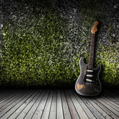 Electric guitar in the empty room — Stock Photo