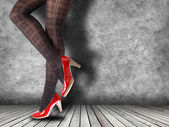 Woman's Legs Wearing Pantyhose and High Heels — Stok fotoğraf