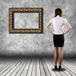 Woman standing in the gallery — Stock Photo #23980169