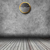 Empty interior with grunge wall and clocks — Stock Photo