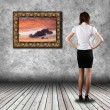 Woman standing in the gallery — Stock Photo #24643121