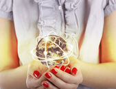 Business woman holds Earth — Stock Photo