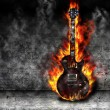 Stock Photo: The burning guitar