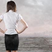 Standing beautiful brunette backside — Stock Photo