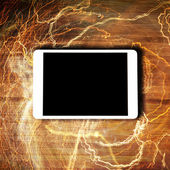 Tablet concept with lightnings — ストック写真