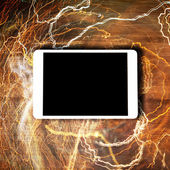 Tablet concept with lightnings — Stock Photo