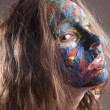 Stock Photo: Young womwith face-art