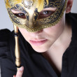 Stock Photo: Elegant girl with a wonderful mask