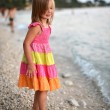 Beautiful girl on a beach on the coast - Stock Photo