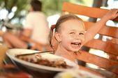 Little girl eating pancake — Stock Photo