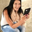 Picture of happy teenage girl with tablet pc computer — Stock Photo #12749799
