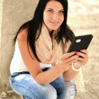 Picture of happy teenage girl with tablet pc computer — Lizenzfreies Foto