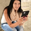 Picture of happy teenage girl with tablet pc computer — Stock Photo #12750265
