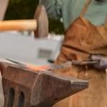 Blacksmith forged iron smith anvil hammerman traditional hammer beating — Stock Photo