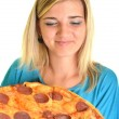Portrait of a young woman eating a pizza over a white background — Stock Photo #13123412
