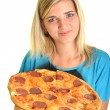Portrait of a young woman eating a pizza over a white background — Stock Photo #13123414